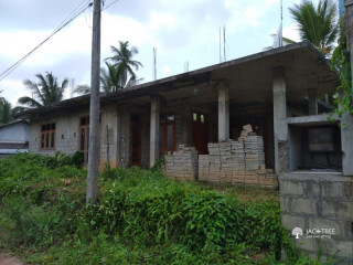 Half build house for sale with land in Pallewela
