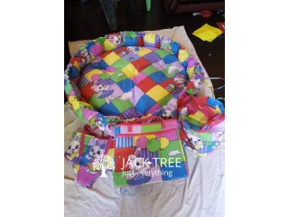 Baby bag with cot sheet